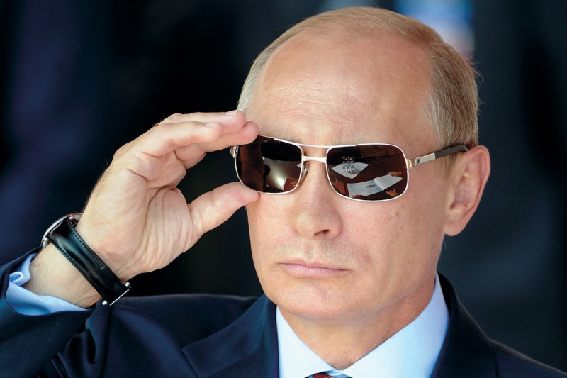 Russian Prime Minister Vladimir Putin watches an air show in Zhukovsky, outside Moscow, on Aug. 17, 2011.