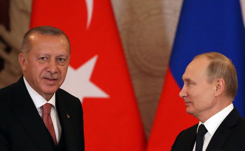 Russian President Vladimir Putin greets Turkish President Recep Tayyip Erdogan during their joint news conference in Moscow on April 8.