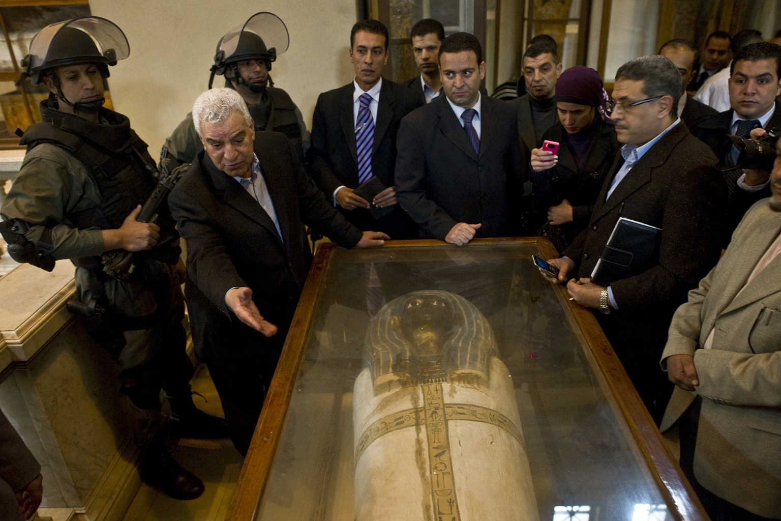 Egyptian state minister of antiquities Zahi Hawass shows one of the pieces damaged by protesters and repaired at the Egyptian Museum on Feb. 16, 2011. Arab Spring demonstrators broke into the museum in Cairo's Tahrir Square, shattering 13 display cases and at least 70 artifacts. (Pedro Ugarte/AFP/Getty Images)