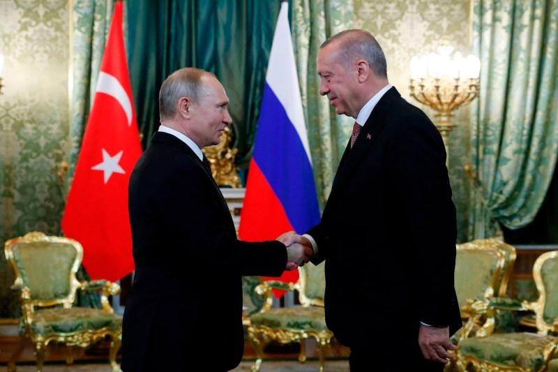 Russian President Vladimir Putin shakes hands with Turkish President Recep Tayyip Erdogan at The Kremlin in Moscow on April 8.