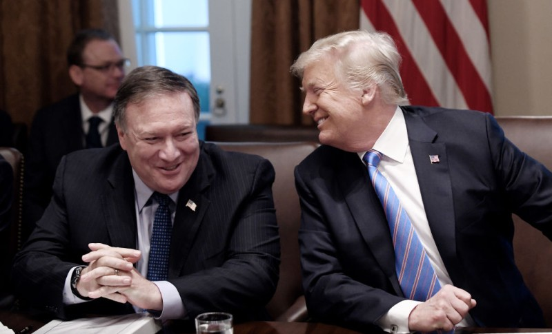Secretary of State Mike Pompeo and President Trump share a laugh during a cabinet meeting with U.S. President Donald Trump in the Cabinet Room of the White House, July 18, 2018 in Washington.
