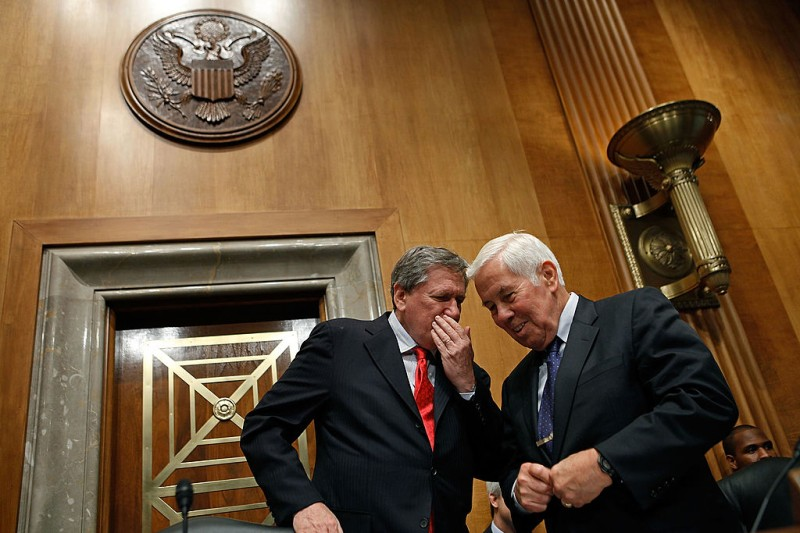 Richard Holbrooke talks with Senate Foreign Relations Committee ranking member Sen. Richard Lugar before a hearing on Capitol Hill July 14, 2010 in Washington.