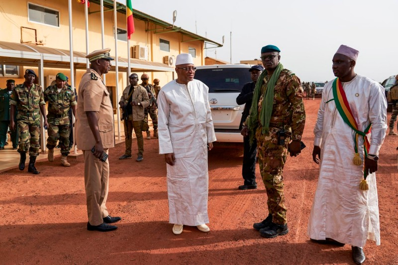 Former Malian Prime Minister Soumeylou Boubeye Maiga (2L) is received in Mopti on his visit to Mali's central region on October 14, 2018. (Photo by Michele Cattani/ AFP/Getty Images)