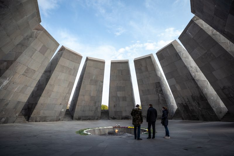 Visitors stand together at Tsitsernakaberd, the Armenian genocide memorial complex, in Yerevan, Armenia, on Nov. 16, 2018.
