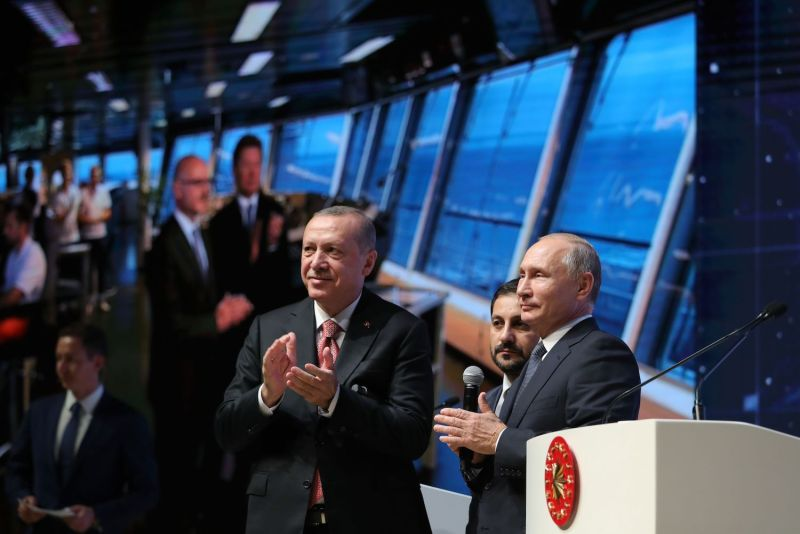 Turkish President Recep Tayyip Erdogan and his Russian counterpart, Vladimir Putin, attend a ceremony marking the completion of the sea part of the TurkStream gas pipeline in Istanbul on Nov. 19, 2018. (Mikhail Klimentyev/AFP/Getty Images)
