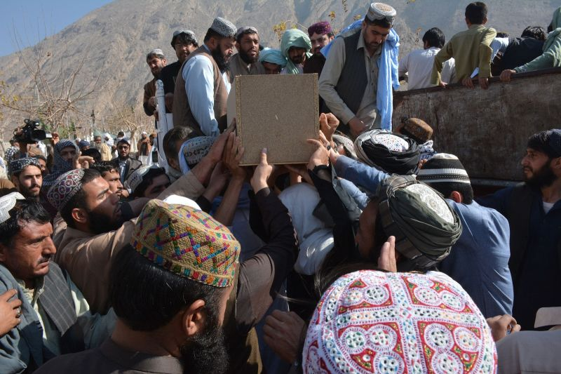 Pakistani mourners bury a victim who were killed in an attack at the Chinese consulate, during a funeral ceremony in Quetta on November 24, 2018. (Banaras Khan/AFP/Getty Images)