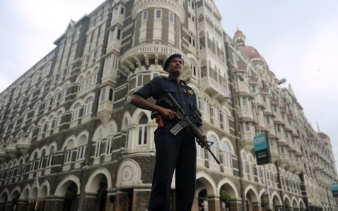 An Indian police commando stands guard in front of the Taj Mahal Palace hotel in Mumbai on November 25, 2010, ahead of the second anniversary of the November 26, 2008 Mumbai attacks. (Punit Paranjpe/AFP/Getty Images)