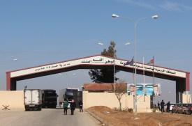 Drivers wait in line at the Jaber-Nasib crossing between Jordan and Syria on Jan. 16. (Laith Joneidi/Anadolu Agency/Getty Images)