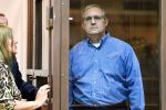 Paul Whelan, a former U.S. Marine accused of espionage and arrested in Russia, listens to his lawyers while standing inside a defendants' cage during a hearing at a court in Moscow on Jan. 22. (Mladen Antonov/AFP/Getty Images)