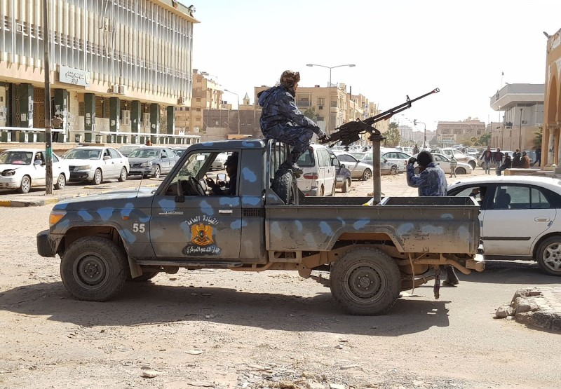Forces loyal to Khalifa Haftar patrol in the southern Libyan city of Sabha, on February 9. (AFP/Getty Images)