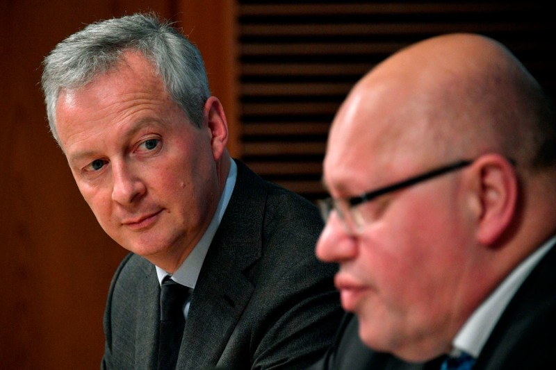 French Economy Minister Bruno Le Maire, left, with his German counterpart, Peter Altmaier, discuss European Union industrial policy on Feb. 19. (John MacDougall/AFP/Getty Images)