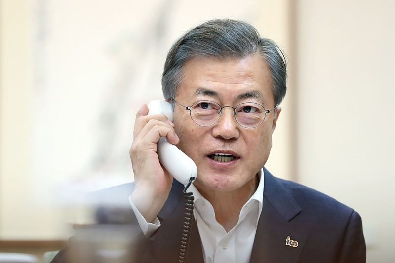 South Korean President Moon Jae-in talks on the phone with U.S. President Donald Trump at the presidential Blue House on February 28, 2019 in Seoul. (Photo by South Korean Presidential Blue House via Getty Images)
