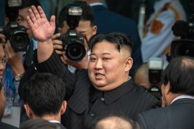 North Korean leader Kim Jong Un waves to a crowd in Dong Dang, Vietnam on March 2. (Carl Court/Getty Images)
