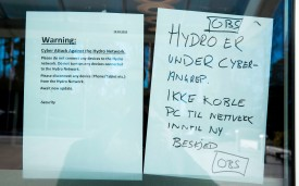 Instructions are posted in window of the headquarters of the Norwegian aluminum group Norsk Hydro, following a cyberattack, in Oslo on March 19.