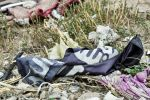 A discarded Islamic State flag lies torn on the ground in the village of Baghouz, Syria, on March 24. (Giuseppe Cacace/AFP/Getty Images)