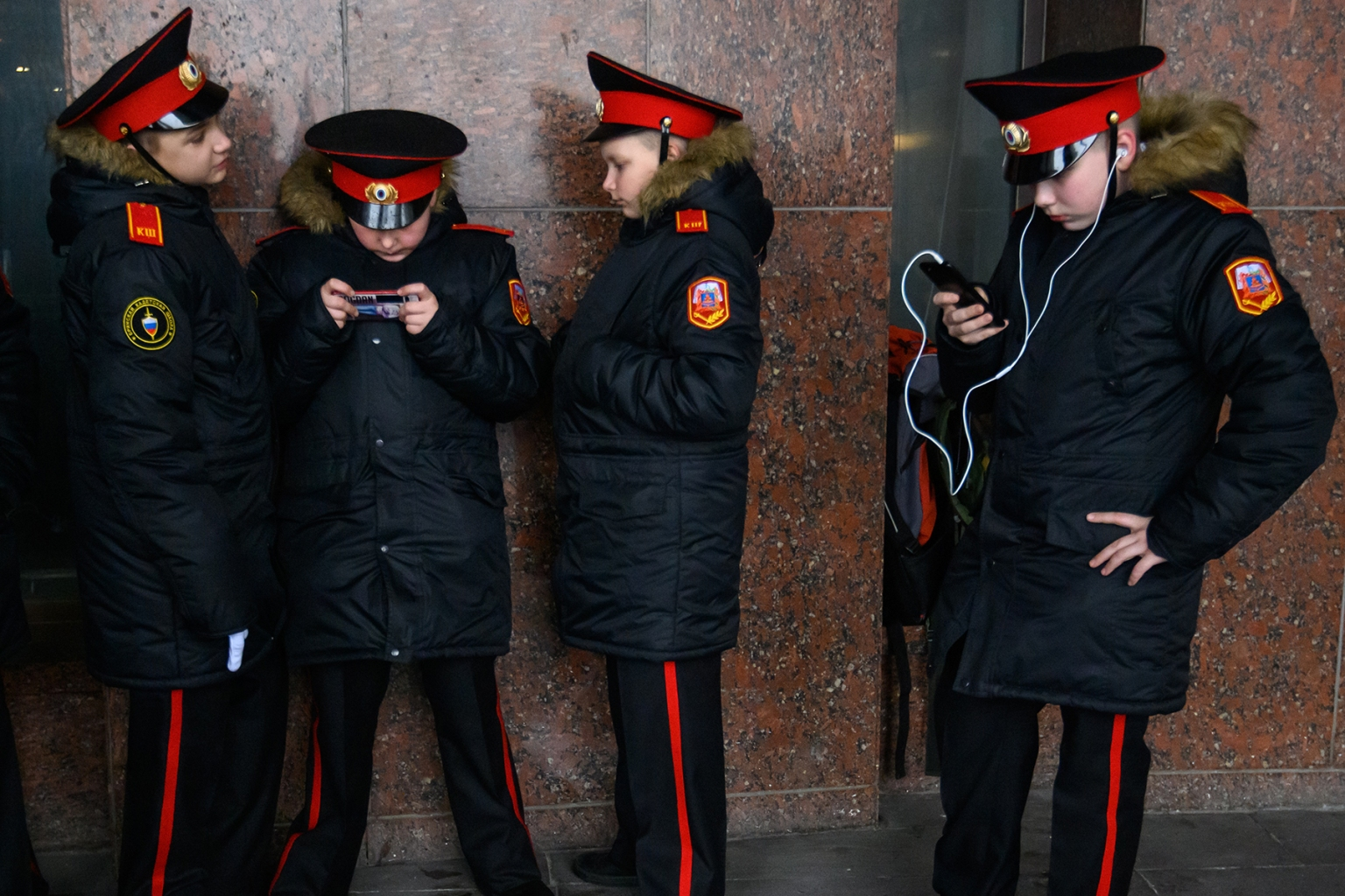 Russian cadets use their mobile phones during the annual cadet schools get-together in Moscow on March 29. MLADEN ANTONOV/AFP/Getty Images