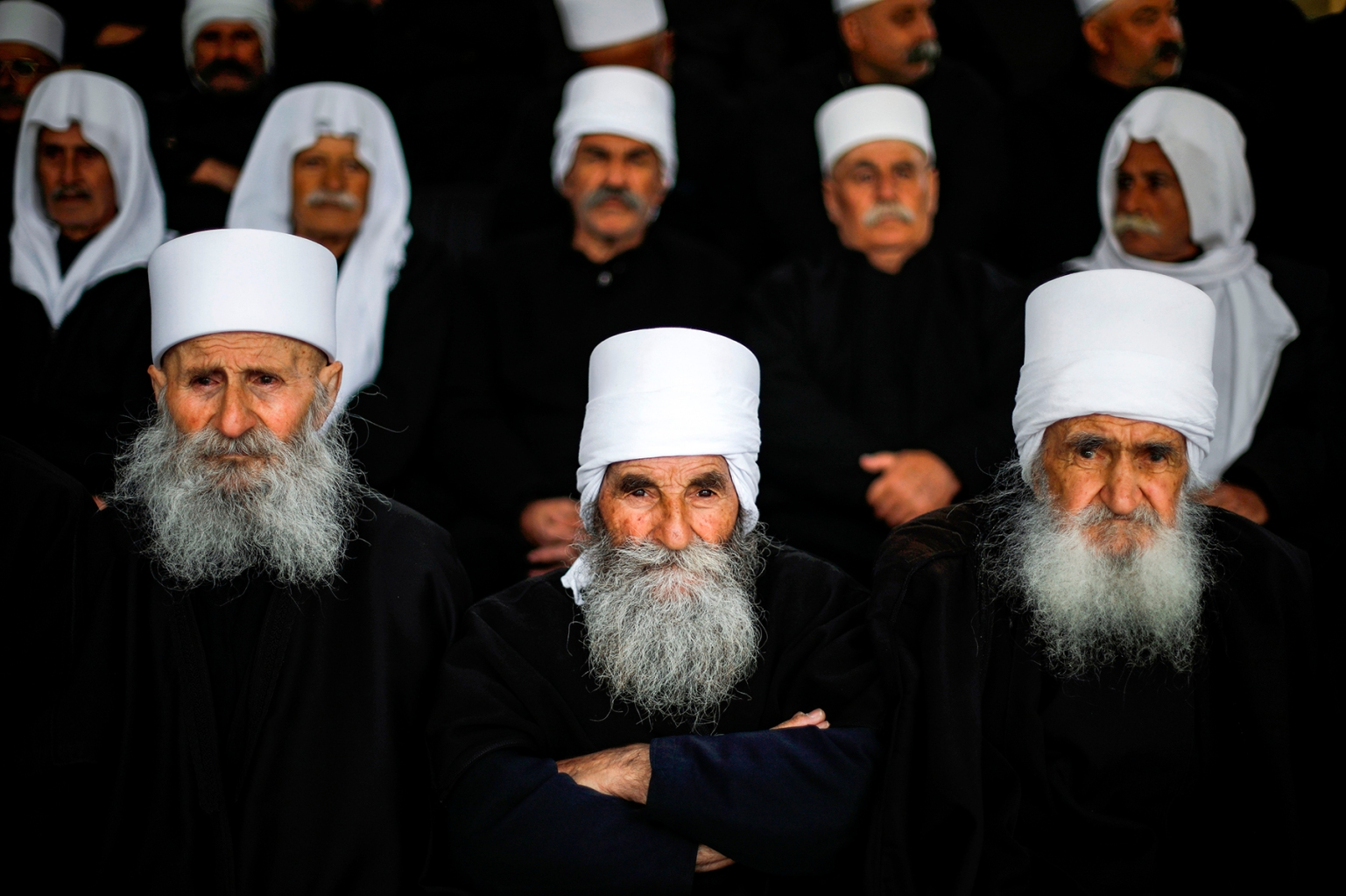 Elderly Druze men gather during a protest against U.S. President Donald Trump's recognition of Israel's annexation of the Golan Heights, in the Druze village of Buqata, on March 30. JALAA MAREY/AFP/Getty Images