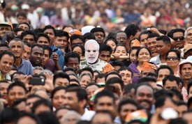A supporter of the Bharatiya Janata Party wears a mask of Prime Minister Narendra Modi at one of Modi's political campaign events ahead of India's general election in Gohpur on March 30. (Biju Boro/AFP/Getty Images)