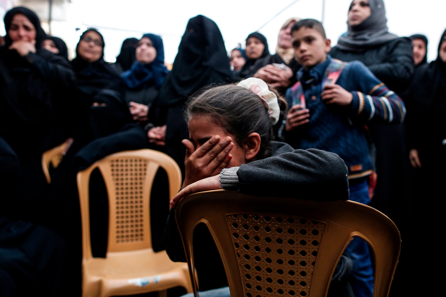 Relatives of Bilal al-Najjar, 17, mourn during his funeral in Khan Yunis in the southern Gaza Strip after four Palestinians were killed by Israeli fire on March 31. MAHMUD HAMS/AFP/Getty Images