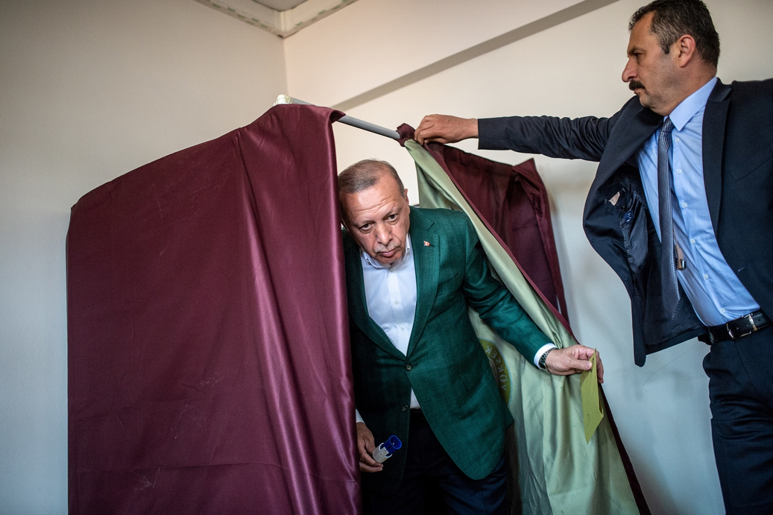 Turkish President Tayyip Erdogan exits a polling booth after casting his ballot during the municipal elections in Istanbul on March 31. BULENT KILIC/AFP/Getty Images
