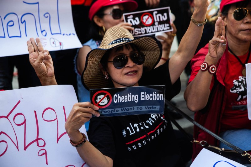 "Thailand's ""Red Shirts,"" a group that began in support of Thaksin Shinawatra and against the military government, protest in Bangkok on March 31. (Lauren DeCicca/Getty Images)"