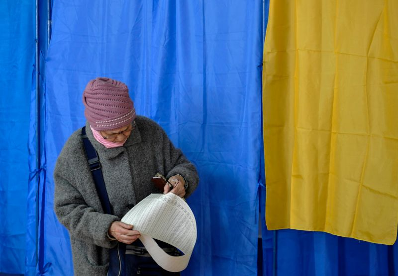 A Ukrainian voter examines her ballot at a polling station during the first round of the Ukrainian presidential elections in Kiev on March 31. (Sergei Chuzavkov/SOPA Images/LightRocket/Getty Images)