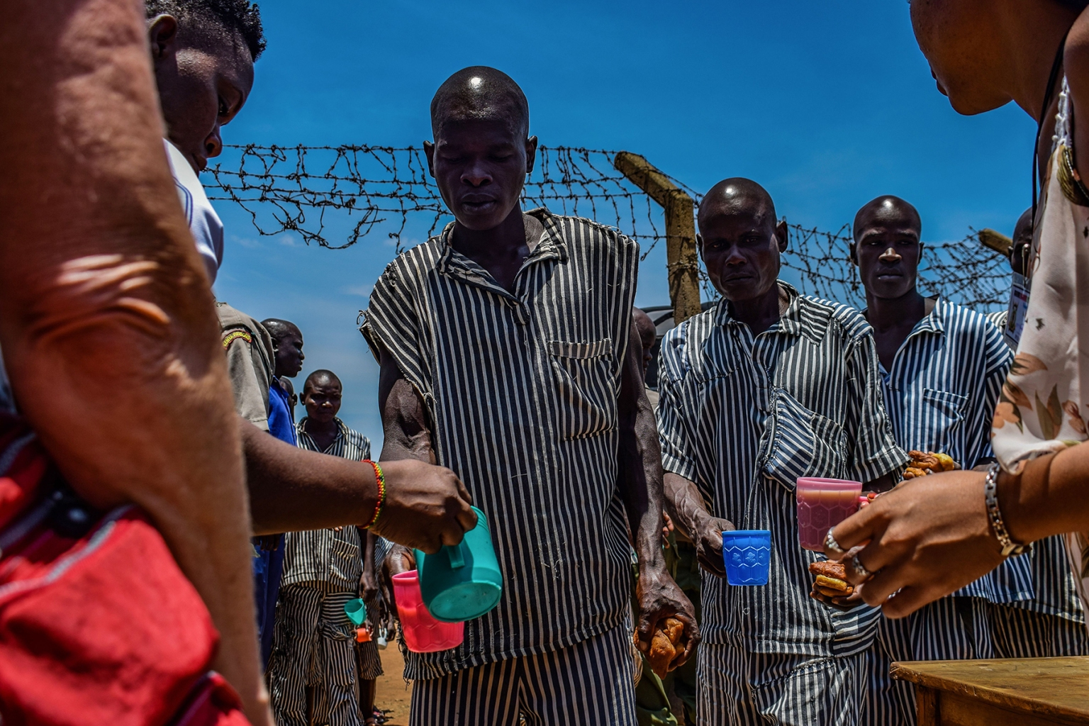 Inmates stand in a queue as they are served tea during a talent show at the medium security section of Kodiaga Prison in Kisumu, Kenya, on March 31. BRIAN ONGORO/AFP/Getty Images