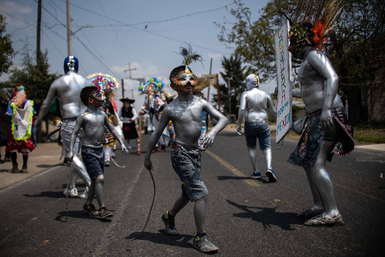 Young residents of the San Nicolas de los Ranchos community, in Puebla state, Mexico, wearing masks and with their bodies painted with oil, parade and dance in the town's traditional carnival on March 31. A ritual performed for good harvests, this year's event also honors the nearby Popocatepetl volcano, which has been increasingly active in recent days. PEDRO PARDO/AFP/Getty Images)