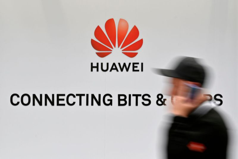 A visitor walks past the logo of the Chinese telecom giant Huawei at the Hannover Messe technology fair in Hanover, Germany, on April 1. (JOHN MACDOUGALL/AFP/Getty Images)