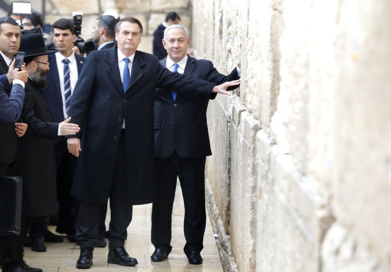 Brazilian President Jair Bolsonaro and Israeli Prime Minister Benjamin Netanyahu touch the Western Wall in the Old City of Jerusalem on April 1. (Menahem Kahana/AFP/Getty Images)