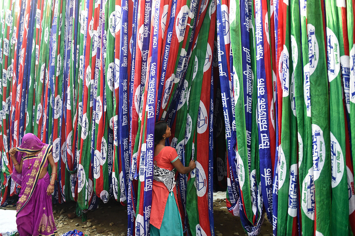 Indian workers dry textile materials dedicated to the Lok Janshakti Party ahead of India's general election, on the outskirts of Ahmedabad, on April 1. SAM PANTHAKY/AFP/Getty Images