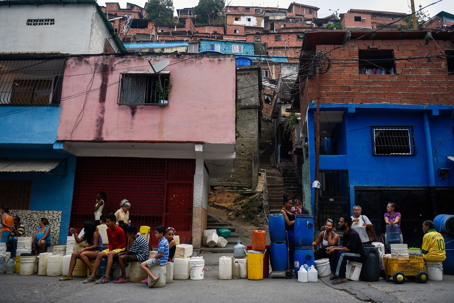 People line up to collect water in the Petare neighborhood in Caracas, Venezuela, on April 1. FEDERICO PARRA/AFP/Getty Images