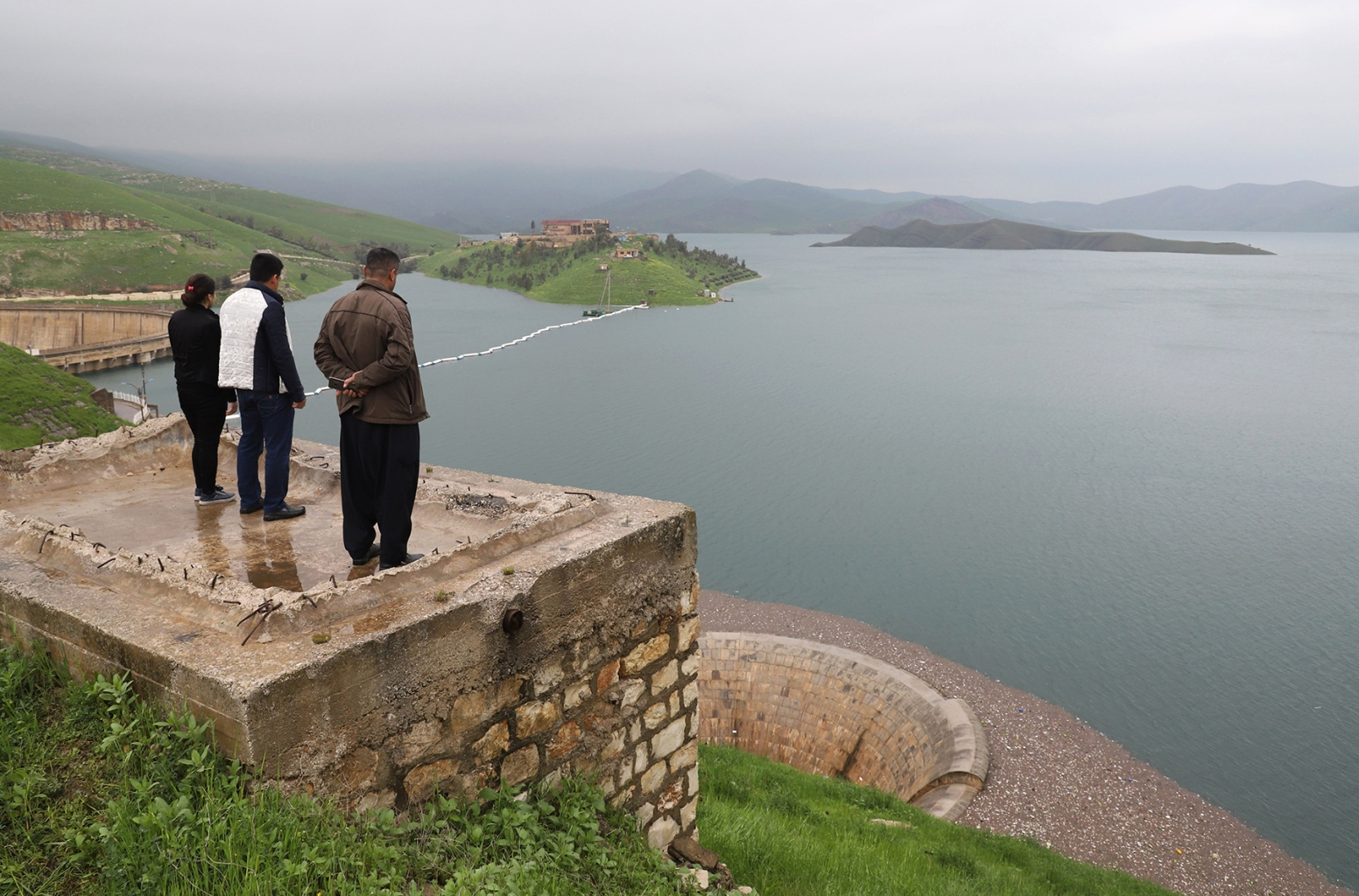 People look over waters filling the Dukan dam in Iraq's northern autonomous region of Kurdistan, which was built in 1955 and has reached its highest levels following heavy rains in the region, on April 2. SHWAN MOHAMMED/AFP/Getty Images