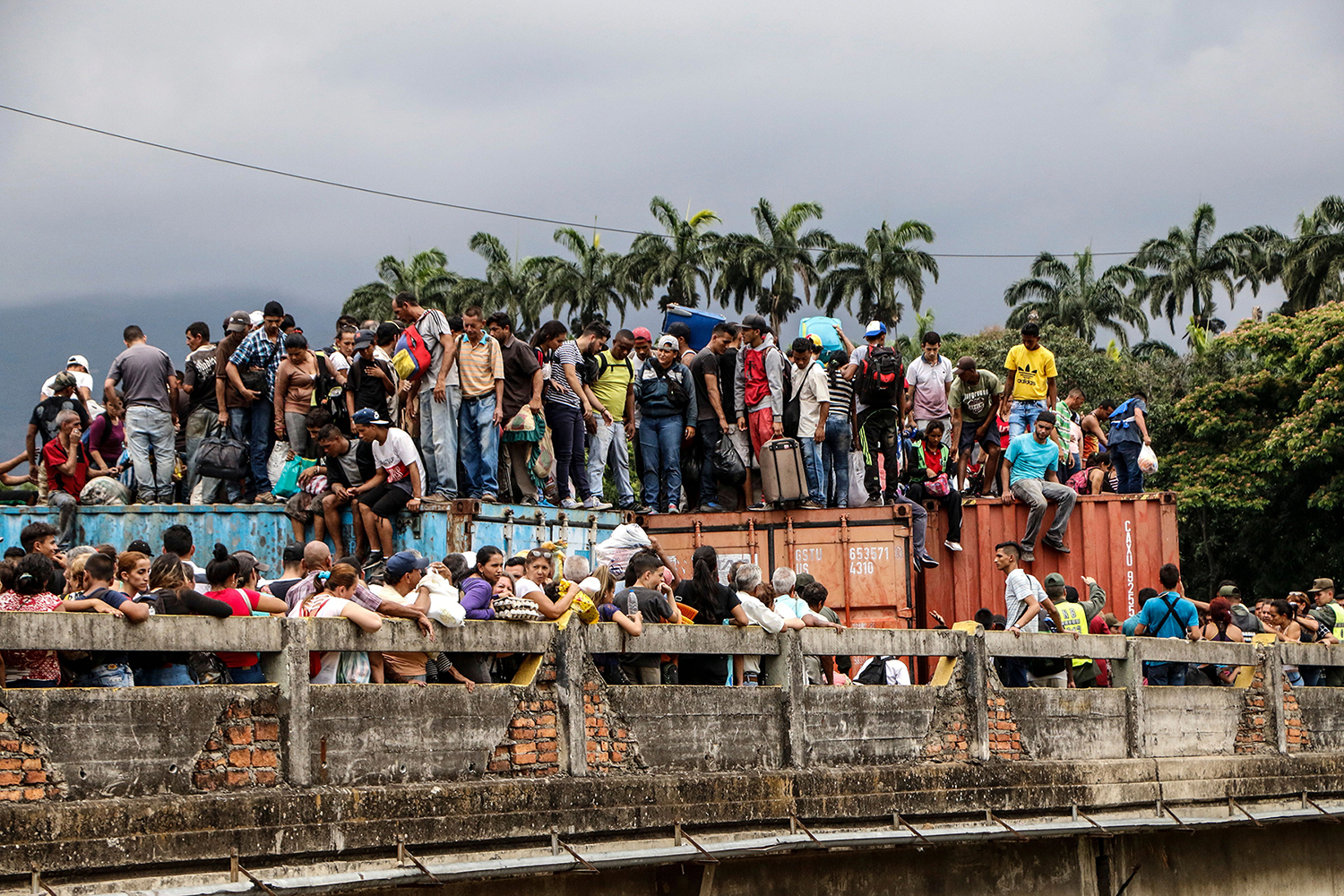 Venezuelans stand atop containers as they attempt to cross the blocked Simon Bolivar international bridge in Cucuta, Colombia, at the border with Venezuela on April 2. SCHNEYDER MENDOZA/AFP/Getty Images