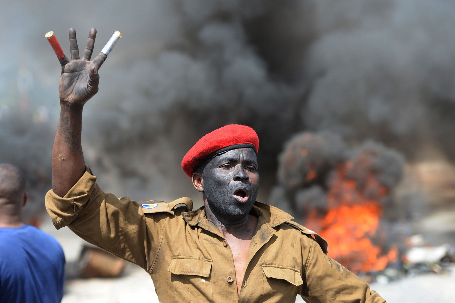 An Alexandra township resident gestures during clashes with the Johannesburg Metro Police in South Africa on April 3 during a shutdown of the township during protests against the lack basic necessities such as access to water, electricity, affordable housing, and public road maintenance. STRINGER/AFP/Getty Images