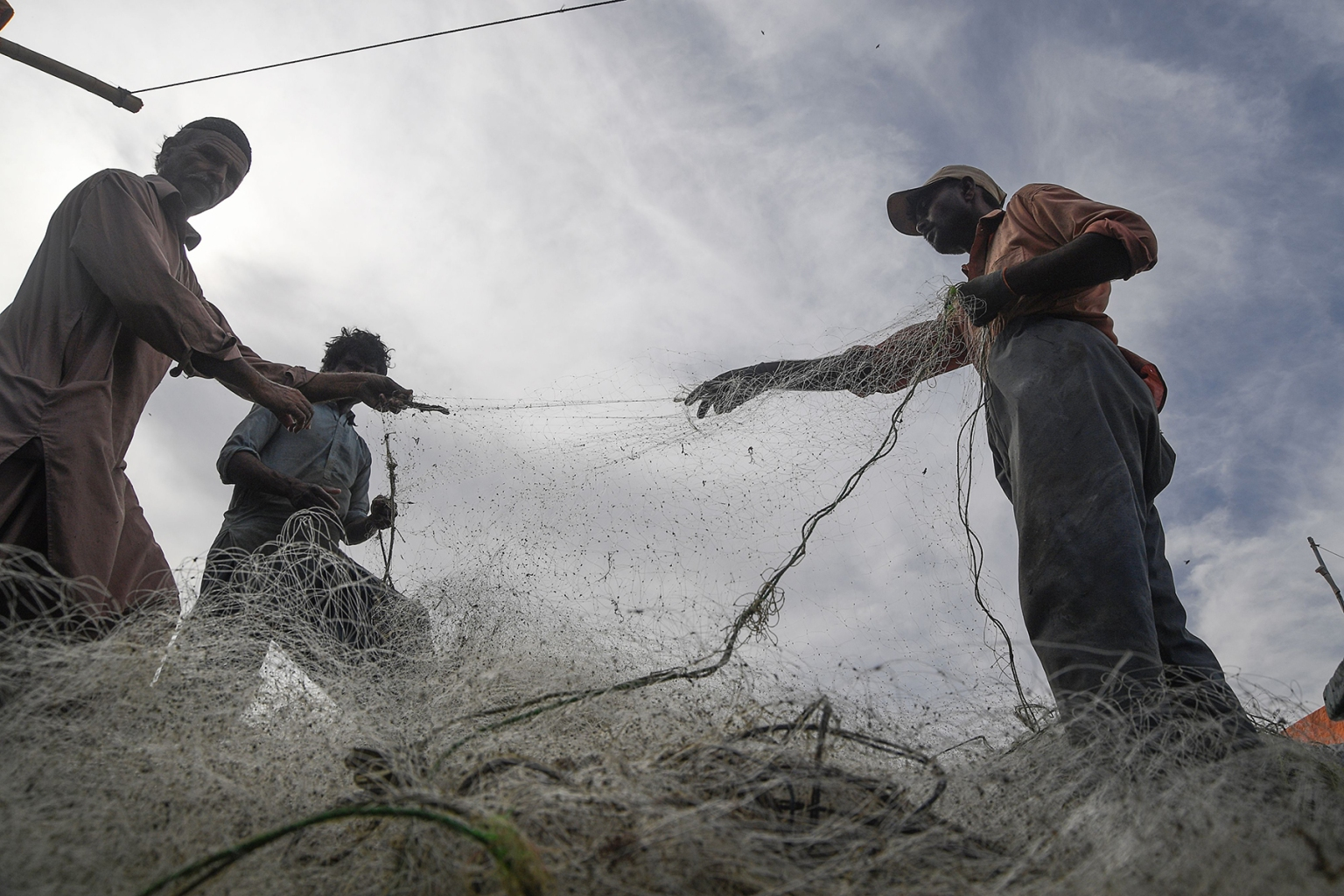 Pakistani fishermen prepare their nets in Karachi on April 3. ASIF HASSAN/AFP/Getty Images