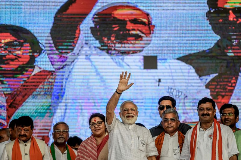 Indian Prime Minister Narendra Modi waves at a public rally in Kolkata, India, on April 3. (Atul Loke/Getty Images)
