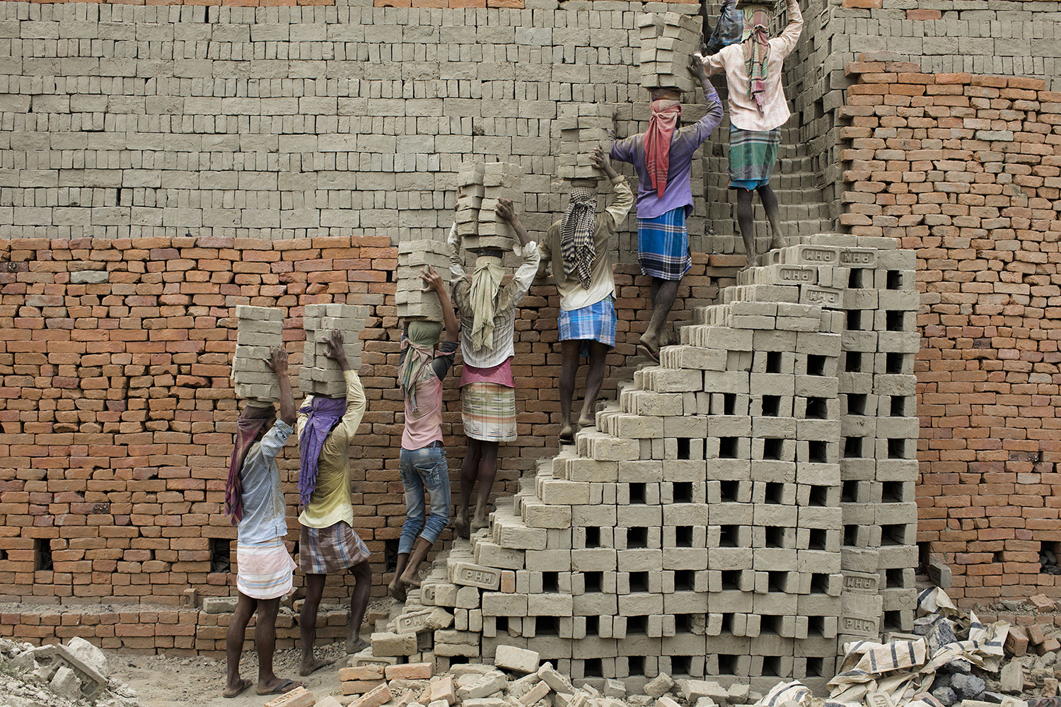 Indian laborers carry clay bricks to a kiln in Farakka, in the Indian state of West Bengal, on April 3. XAVIER GALIANA/AFP/Getty Images