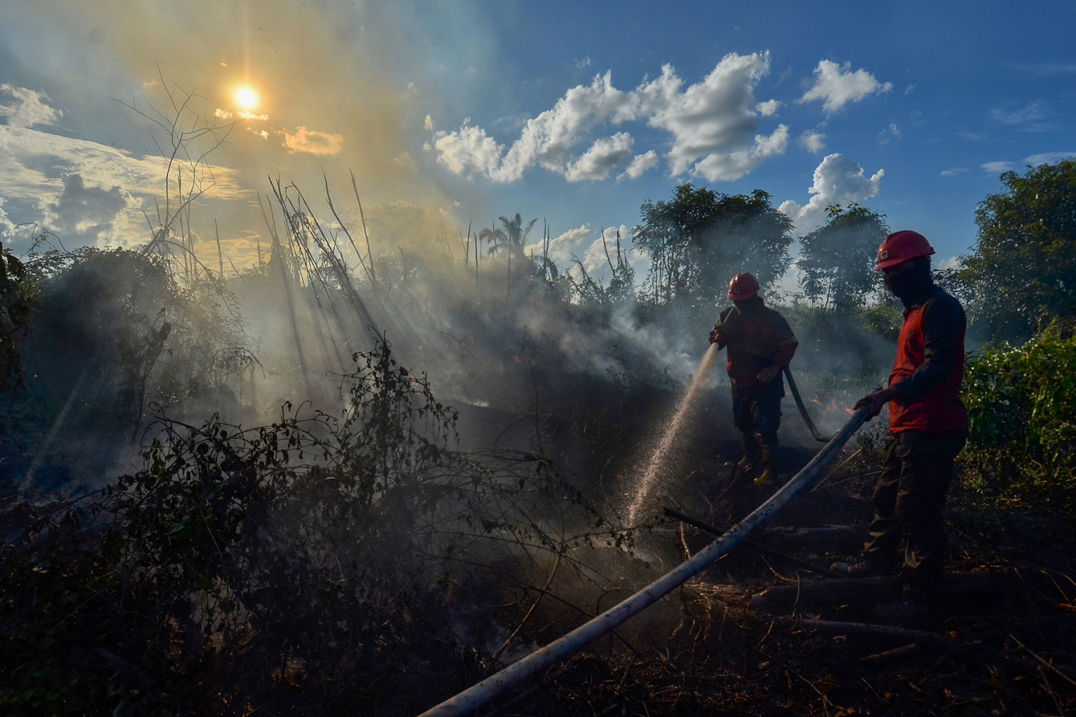 Firefighters extinguish a peatland fire at Karya Indah village in Kampar, Riau province, Indonesia, on April 3. WAHYUDI/AFP/Getty Images