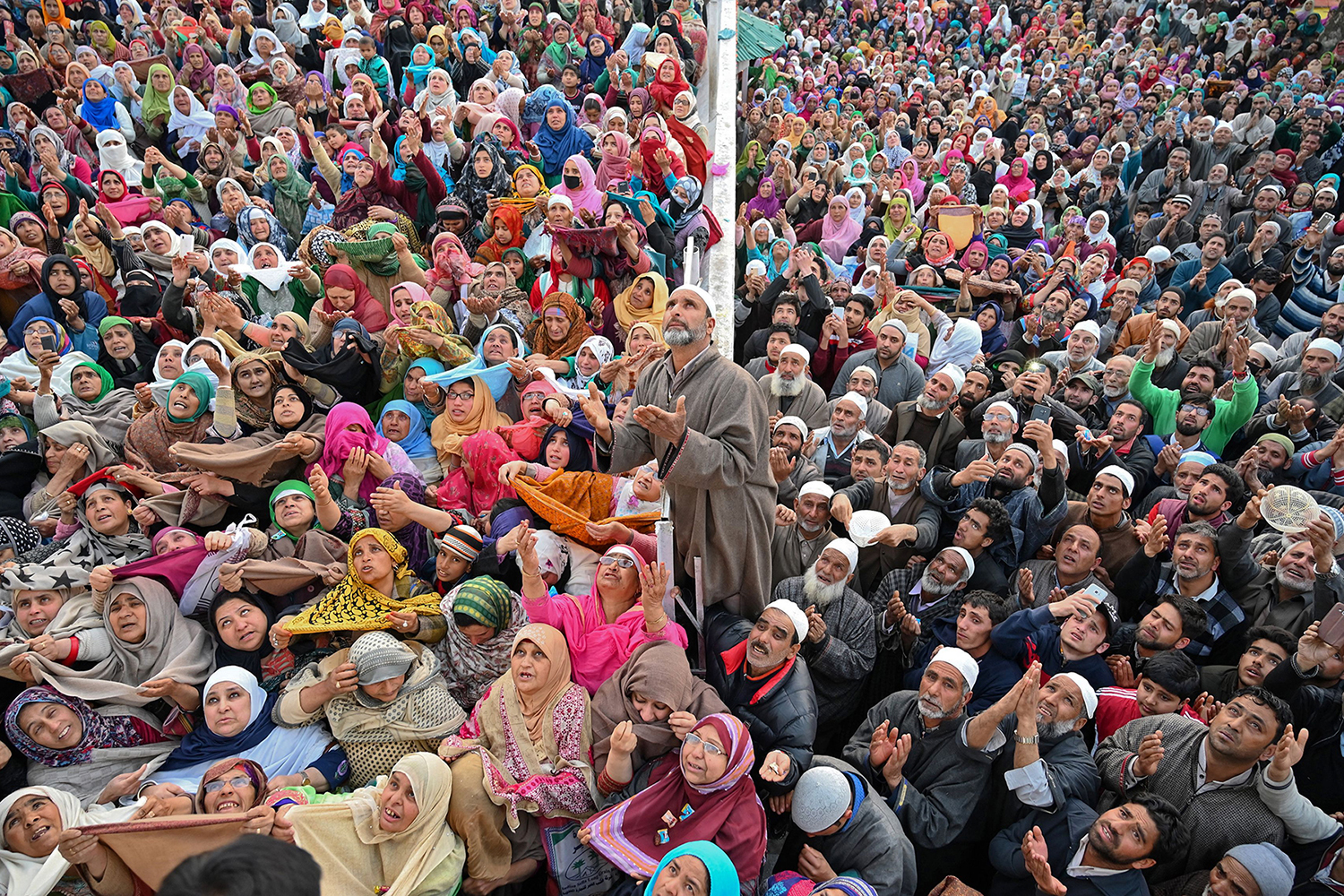 Kashmiri Muslims pray as a cleric displays a holy relic, believed to be a hair from the Prophet Mohammed's beard, during celebrations for Miraj-Ul-Alam at Kashmir's main Hazratbal shrine in Srinagar on April 4. TAUSEEF MUSTAFA/AFP/Getty Images