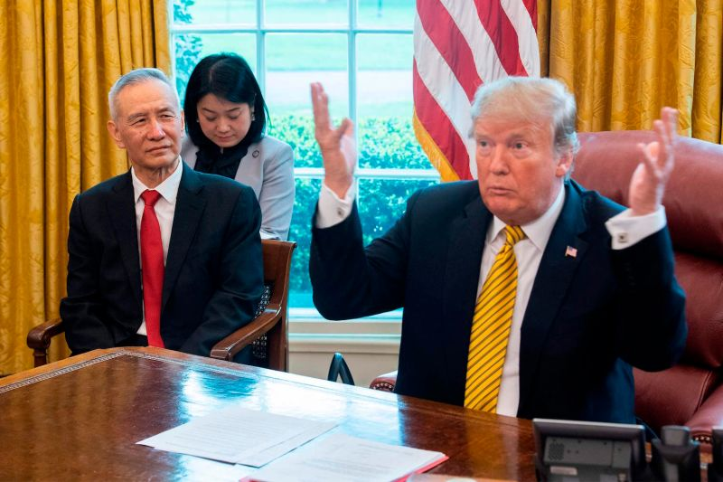 U.S. President Donald Trump discusses trade policy with Chinese Vice Premier Liu He at the White House on April 4. (Jim Watson/AFP/Getty Images)