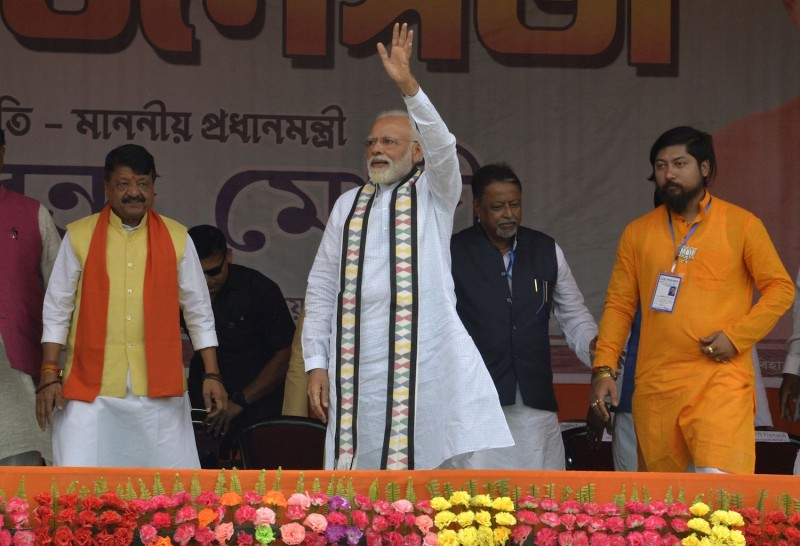 Indian Prime Minister Narendra Modi waves to supporters during a campaign rally ahead of the national elections in Cooch Behar in West Bengal state on April 7. (Diptendu Dutta/AFP/Getty Images)