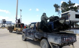 Forces loyal to the internationally recognized Libyan Government of National Accord drive through Tripoli's old international airport on April 8. (Mahmud Turkia/AFP/Getty Images)