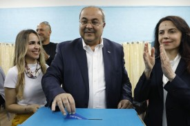 The Israeli Arab politician Ahmed Tibi casts his vote during Israel's parliamentary elections in in the northern Israeli town of Taiyiba on April 9. (Ahmad Gharabli/AFP/Getty Images)