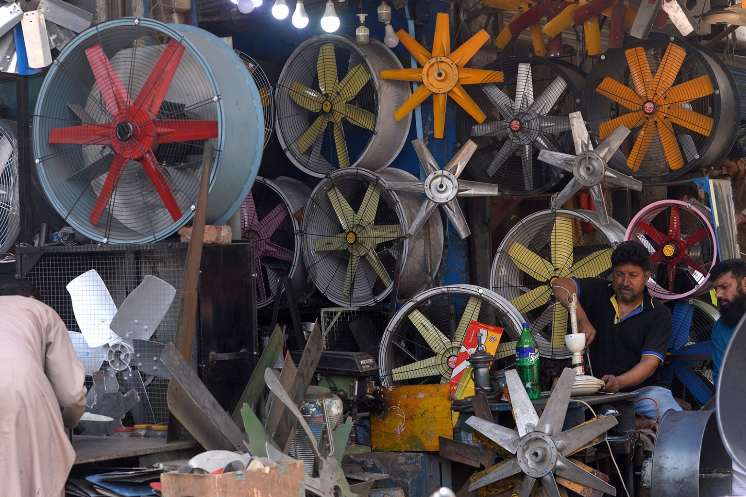 A Pakistani man repairs a fan at his workshop in Lahore on April 9. ARIF ALI/AFP/Getty Images