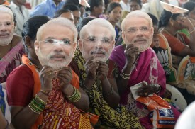 Indian women supporting the Bharatiya Janata Party (BJP) wear masks of Prime Minister Narendra Modi at a rally ahead of the national elections in Hyderabad on April 9, 2019. (Noah Selam/AFP/Getty Images)