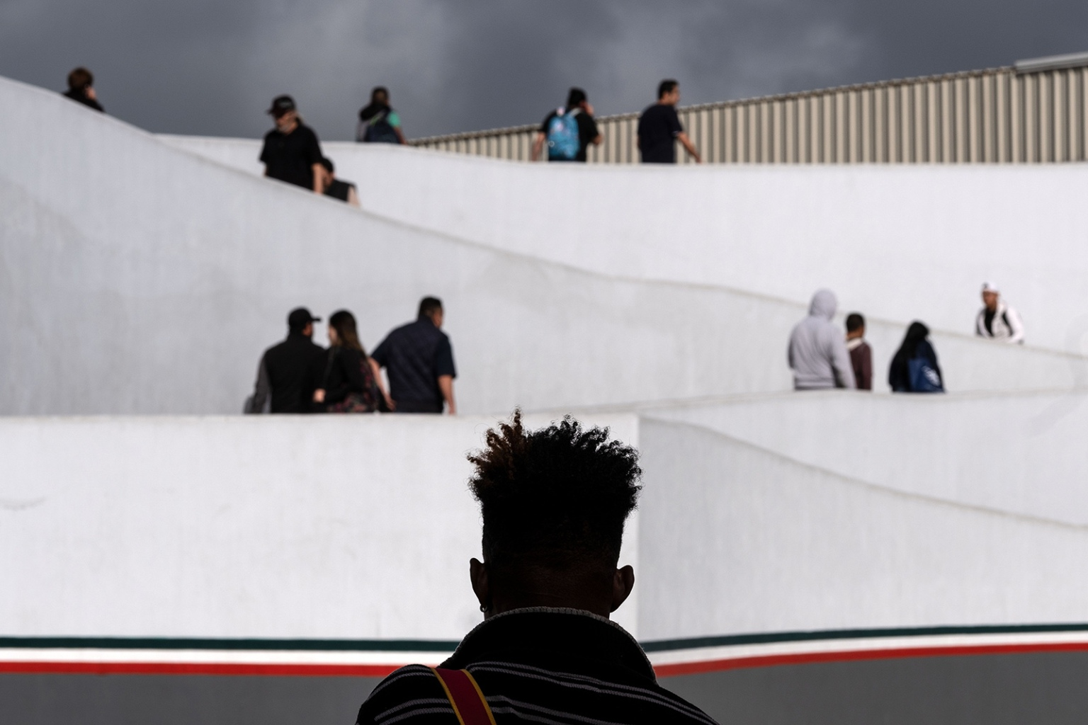A migrant waits outside El Chaparral port of entry as he waits for his turn to request asylum before U.S. border authorities in Tijuana, Mexico, on April 9. GUILLERMO ARIAS/AFP/Getty Images