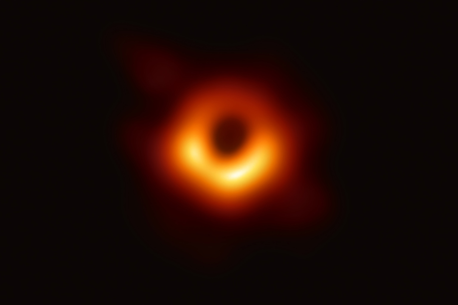 The Event Horizon Telescope captures the first image of a black hole at the center of galaxy M87, outlined by emission from hot gas swirling around it under the influence of strong gravity, in an image released on April 10. National Science Foundation via Getty Images