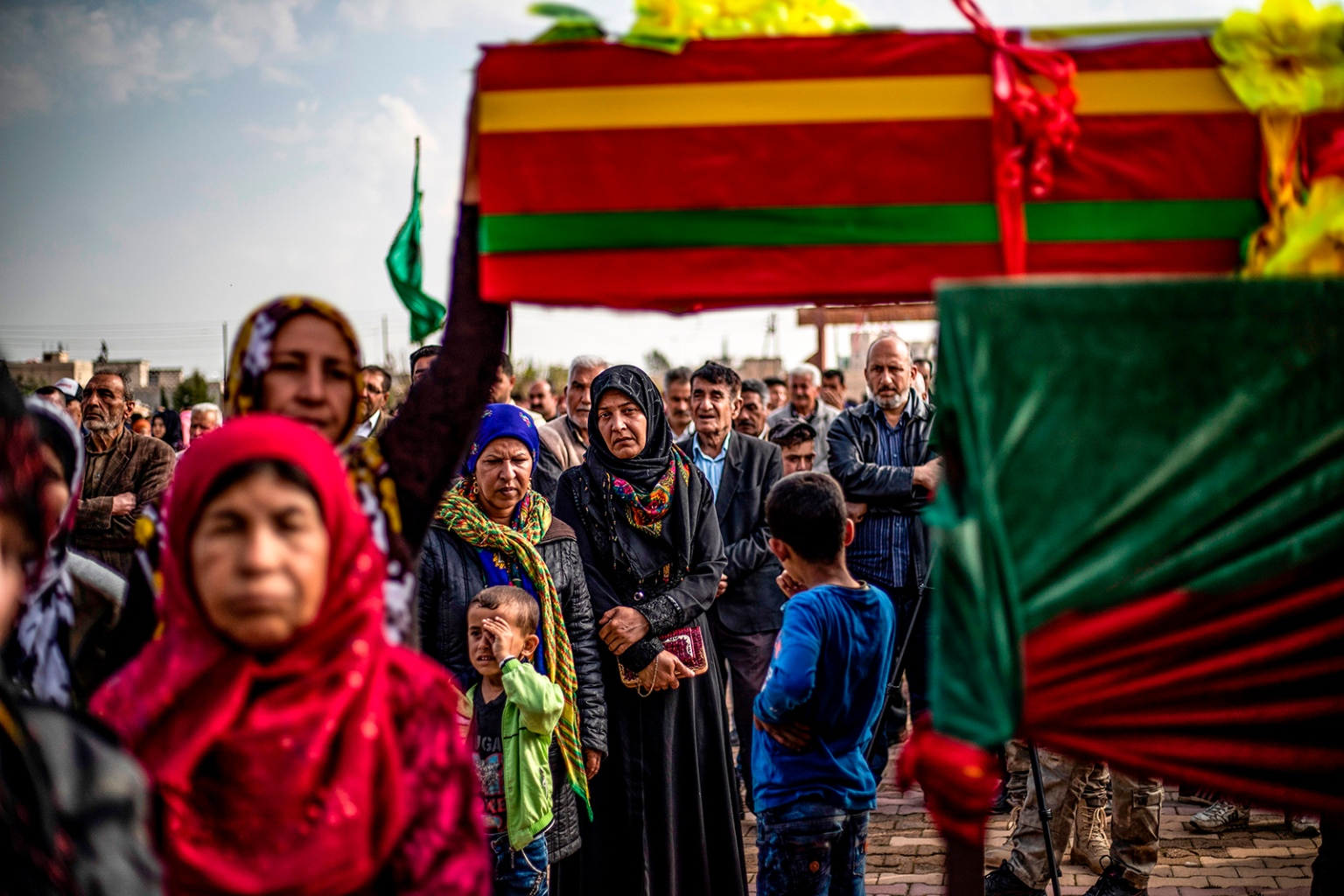 Relatives mourn by the coffin of an Arab fighter in the Kurdish-led Syrian Democratic Forces, who was killed in the eastern Deir Ezzor province, during his funeral in Qamishli, northeastern Syria, on April 10. DELIL SOULEIMAN/AFP/Getty Images