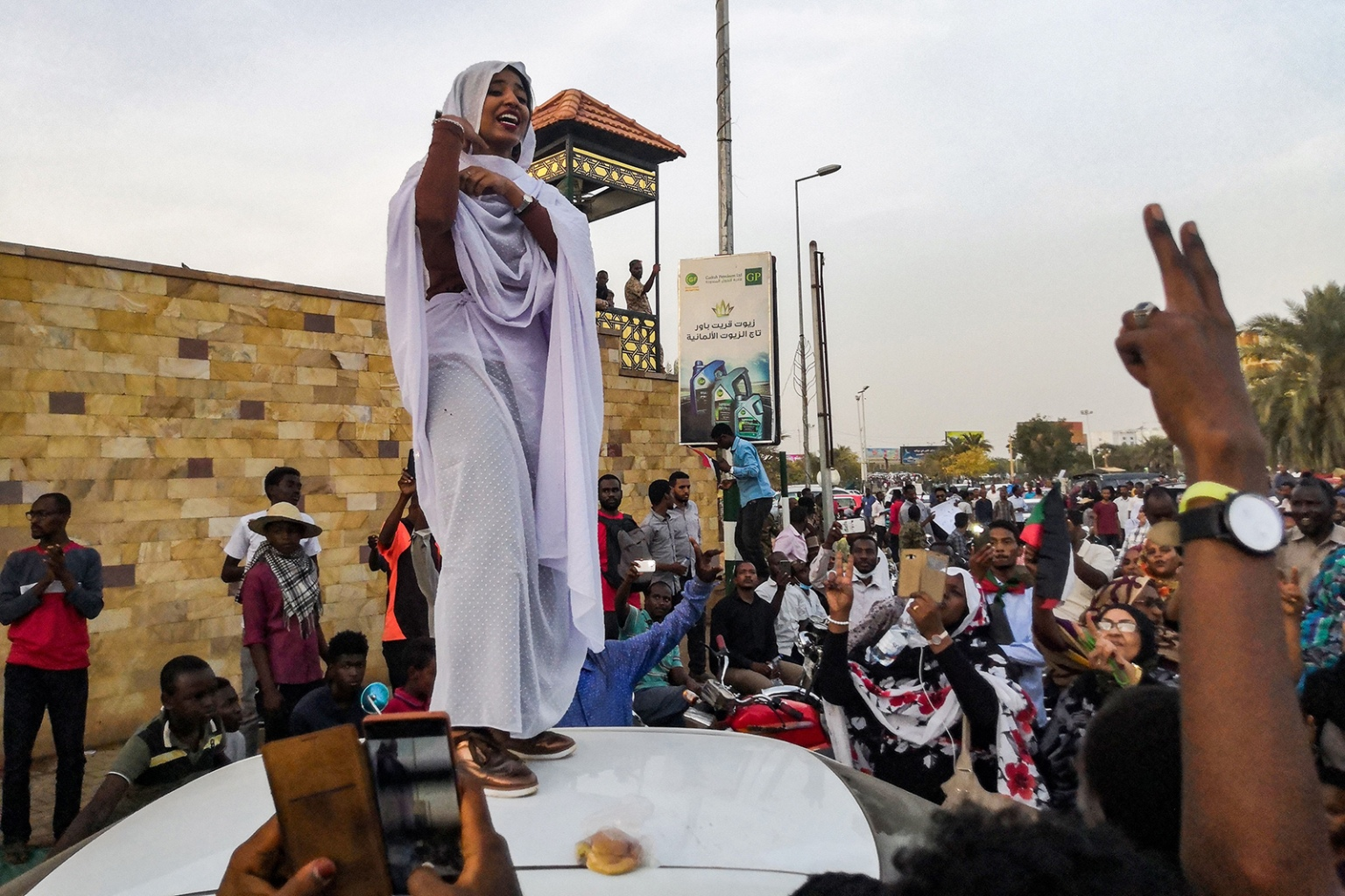 Alaa Salah, a Sudanese woman who propelled to fame earlier this week after clips went viral of her leading chants against President Omar al-Bashir, addresses protesters during a demonstration in front of the military headquarters in the capital Khartoum on April 10. -/AFP/Getty Images